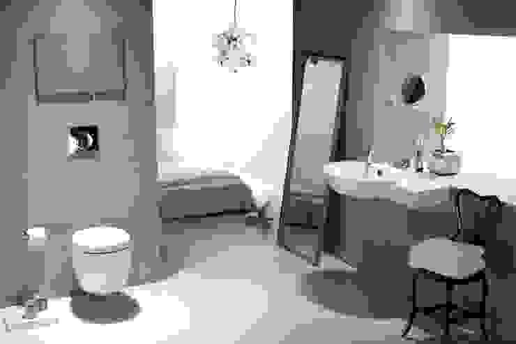 Baños de estilo industrial de Papersky Studio Industrial