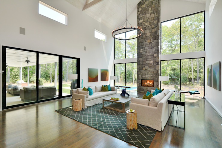 The Modern Barn by Plum Builders Inc. featuring Dunhill Reserve Modern Living Room by Plum Builders Modern Glass