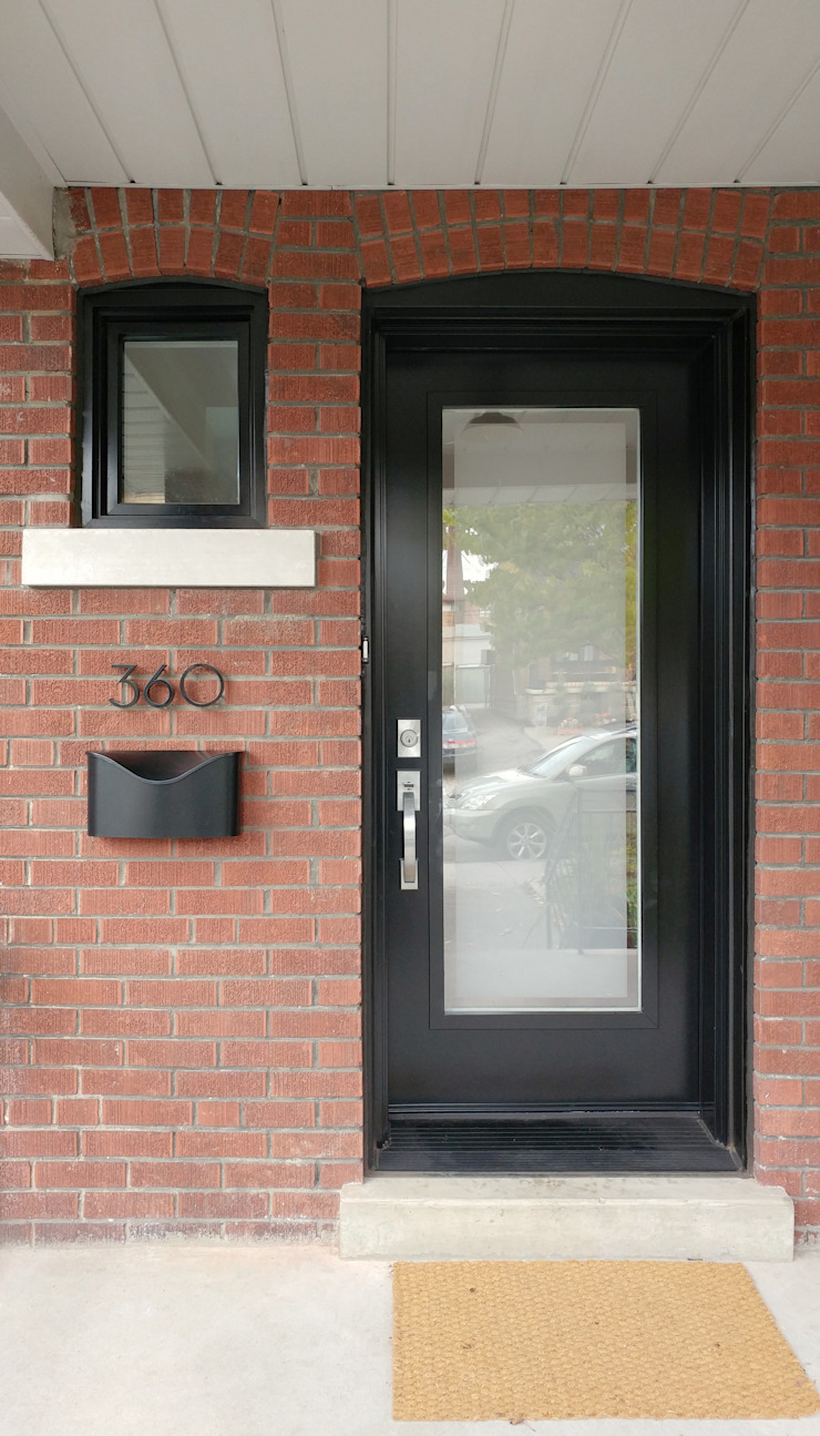 Oakwood Village House - Front Door Solares Architecture Single family home Bricks Brown