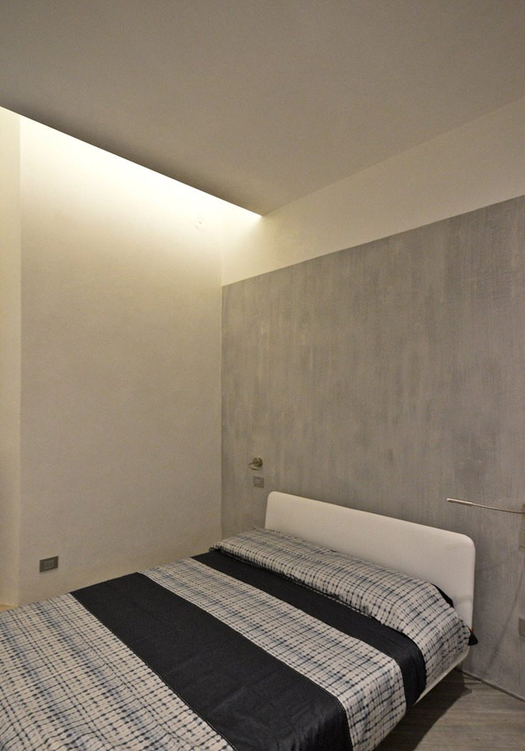Appartamento in centro storico <q>Lui</q> Camera da letto moderna di Studio di Architettura IATTONI Moderno