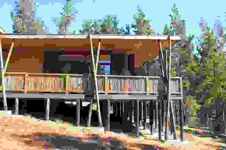 Casa de Fardos Casas de estilo rústico de Kimche Arquitectos Rústico Madera Acabado en madera