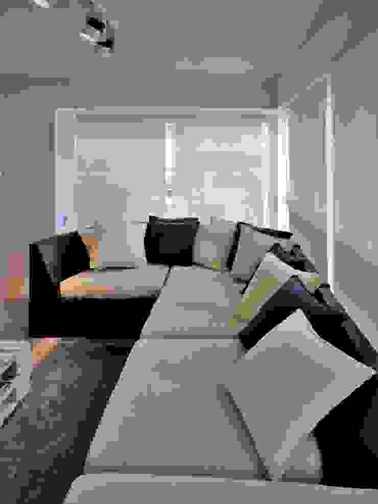 Apartamento de Playa RRA Arquitectura Salas de estilo minimalista Concreto Blanco