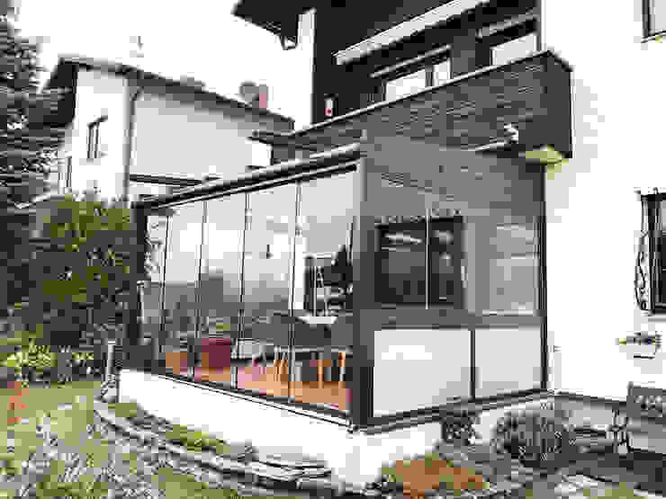 Schmidinger Wintergärten, Fenster & Verglasungen Jardines de invierno de estilo clásico Vidrio Gris
