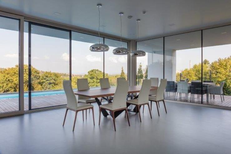 Modern Dining Room by IDEAL WORK Srl Modern Concrete