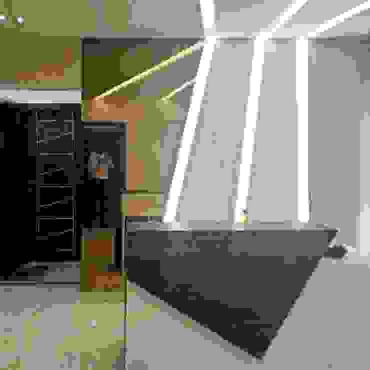 Office in Mumbai by L V Designs Modern Glass