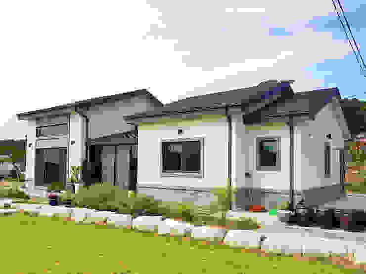 Casas campestres de estilo  por W-HOUSE, Moderno Concreto