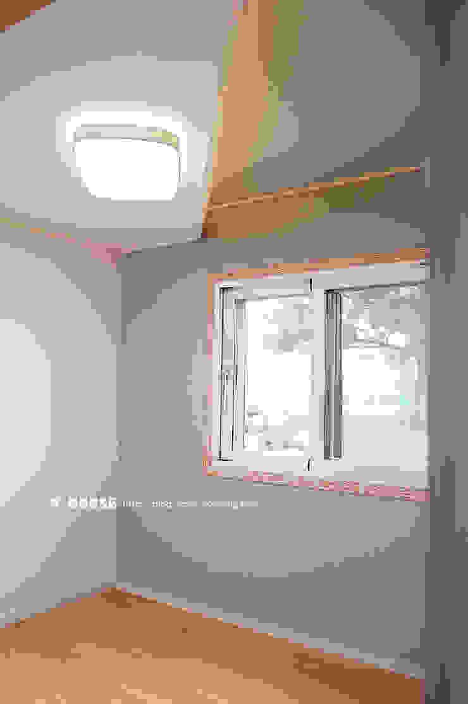 서천 8호 35평형 ALC전원주택 모던스타일 침실 by W-HOUSE 모던 석회암