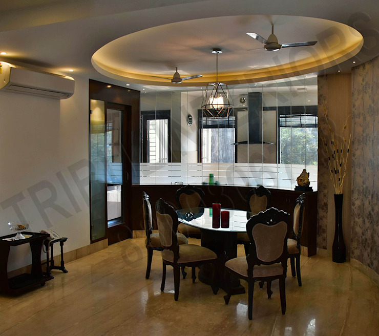 Villa Eclectic style dining room by Tribuz Interiors Pvt. Ltd. Eclectic