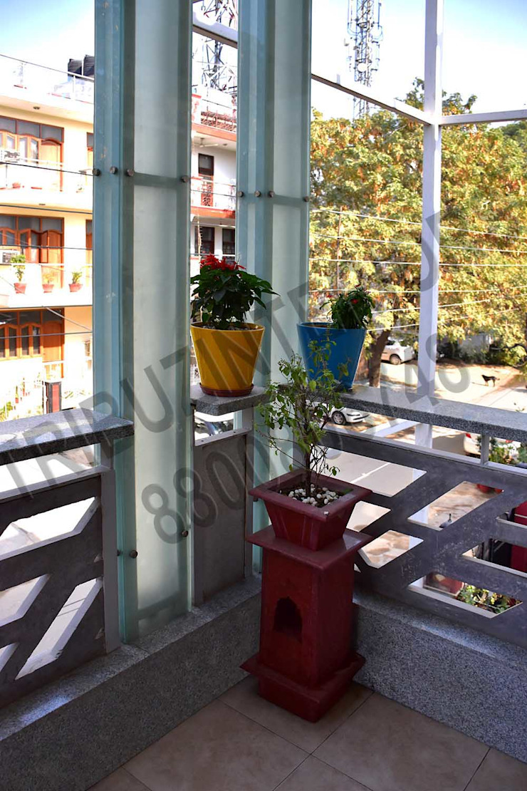 Villa Eclectic style balcony, veranda & terrace by Tribuz Interiors Pvt. Ltd. Eclectic
