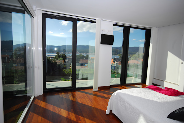 Boiro interior Dormitorios de estilo moderno de Proyectopia Moderno