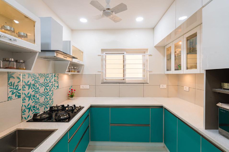 Modern kitchen in turquoise blue and white combination by Rhythm And Emphasis Design Studio