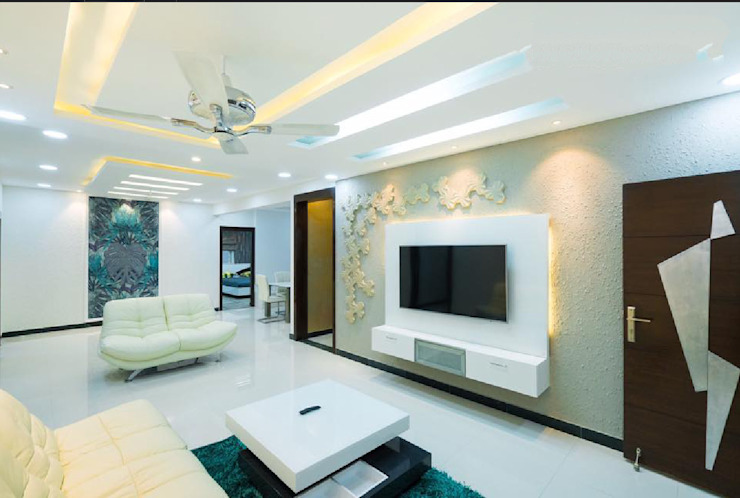 Living room tv unit design with a designer panel as a back ground Rhythm And Emphasis Design Studio Modern living room لکڑی White