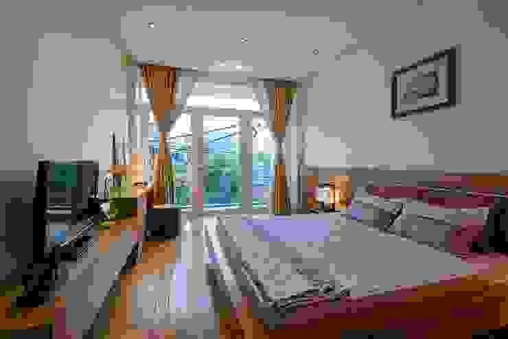 Dormitorios de estilo  de Công ty TNHH Xây Dựng TM – DV Song Phát, Moderno