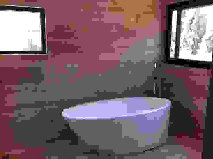 baño casa unifamiliar Baños de estilo moderno de PICHARA + RIOS arquitectos Moderno Mármol