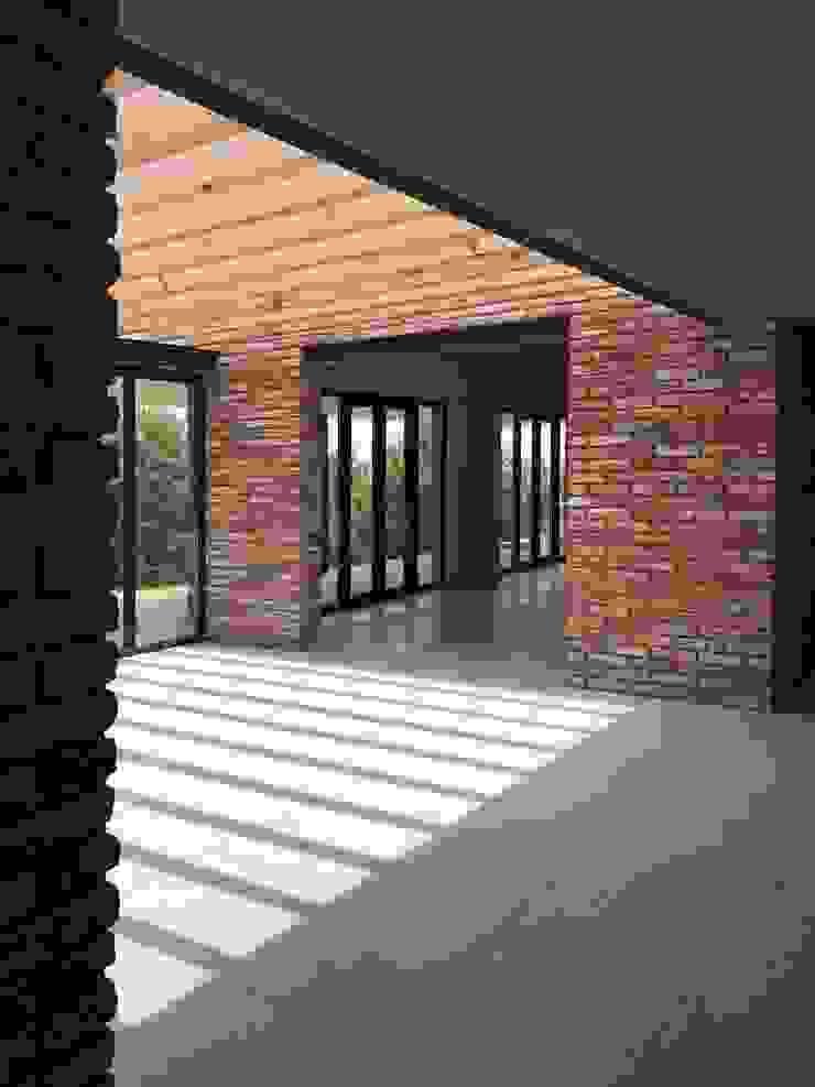 Modern Corridor, Hallway and Staircase by AWA arquitectos Modern Bricks