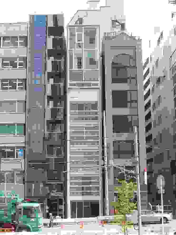 Casas modernas de 有限会社角倉剛建築設計事務所 Moderno Vidrio
