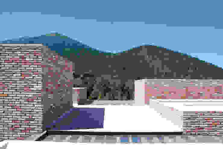 by AWA arquitectos Modern Bricks