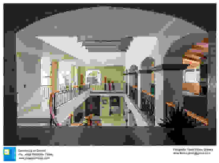 vestibulo en doble altura de Excelencia en Diseño Colonial Concreto