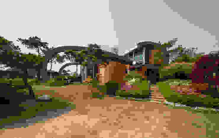Casas de campo de estilo  por D.P.J & Partners