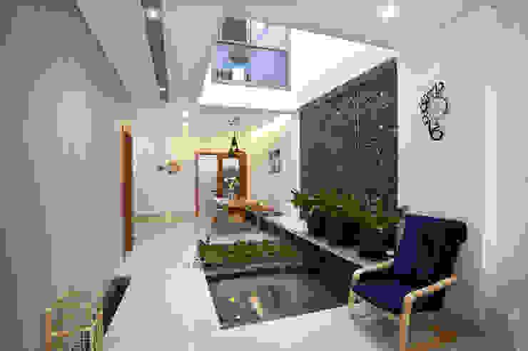 Thiết Kế Nhà Ống 2 Tầng 790 Triệu Gần Gũi Với Thiên Nhiên:  Nhà vườn by Công ty TNHH Xây Dựng TM – DV Song Phát