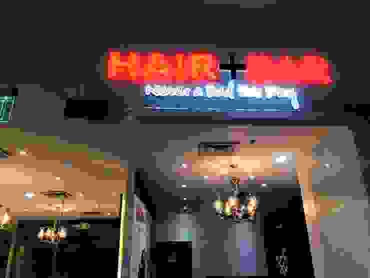 Hair + Bar salon by Geek Architects