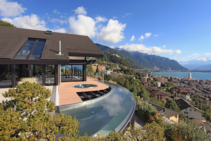 Haus am Hang in Genf am See - CH DAVINCI HAUS GmbH & Co. KG Moderne Pools