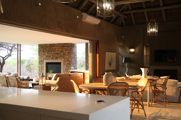 new lodge  |  leopard creek estate:  Living room by drew architects + interiors, Modern Wood Wood effect