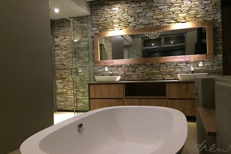 modern lodge Modern bathroom by drew architects + interiors Modern Stone