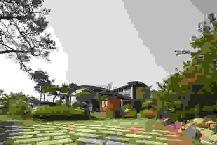 Casas de estilo  por D.P.J & Partners