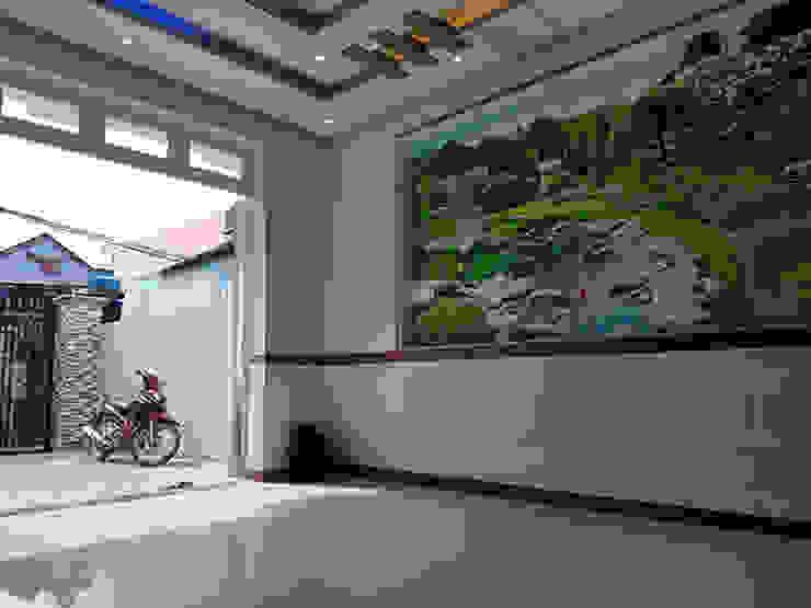 Gia chủ đã chọn màu sơn trắng làm màu chủ đạo. Phòng khách phong cách châu Á bởi Công ty TNHH TK XD Song Phát Châu Á Đồng / Đồng / Đồng thau