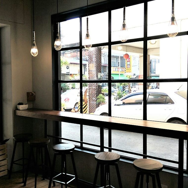 Industrial style dining room by 喬克諾空間設計 Industrial