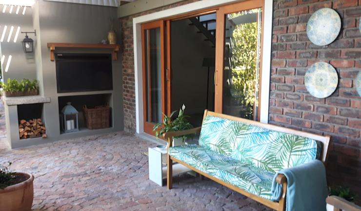 Braai area:   by Bibby Interior Design,
