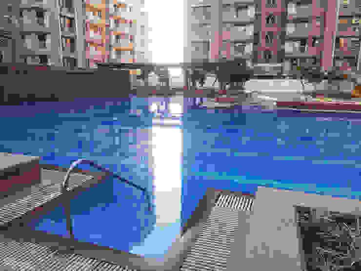 Swimming pool Modern garden by NMP Design Modern
