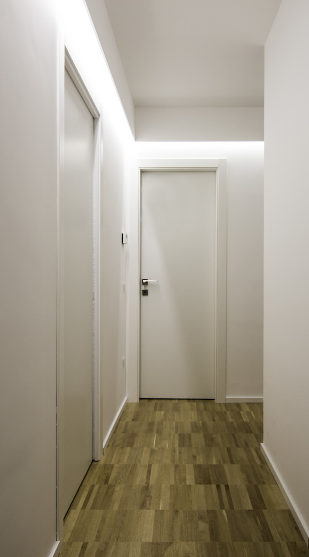 MG_Home Ingresso, Corridoio & Scale in stile minimalista di Domenico Architetto Moschetto Minimalista