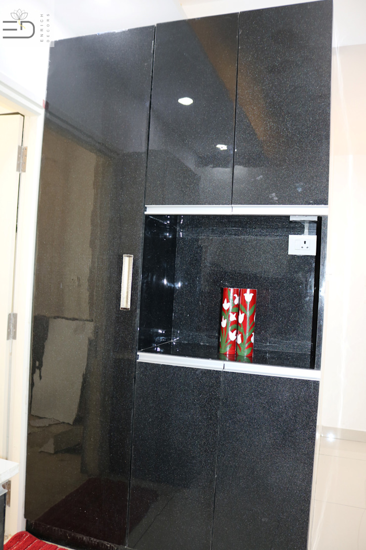 Tall Unit Storage with microwave provision by Enrich Interiors & Decors Modern Plywood