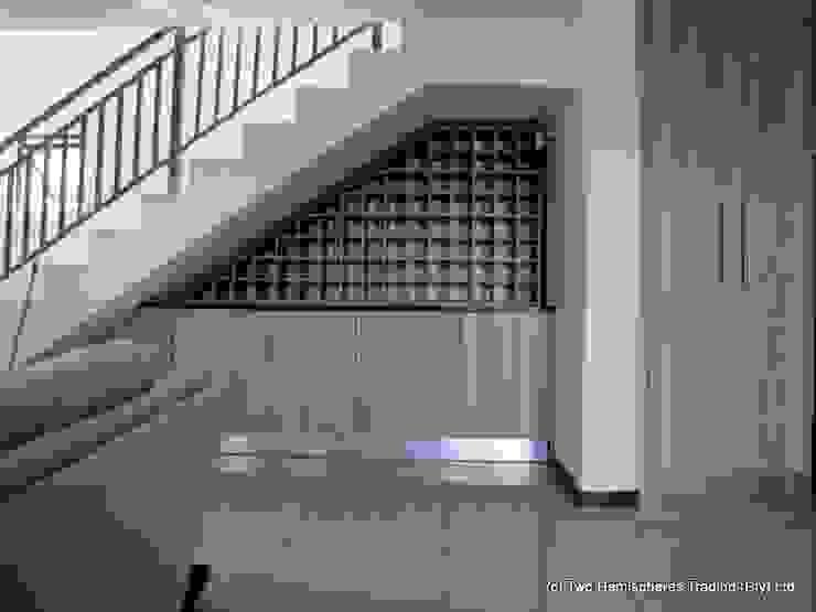 The Under-Stairs Wine Rack Modern kitchen by Drake Williams Decor Modern