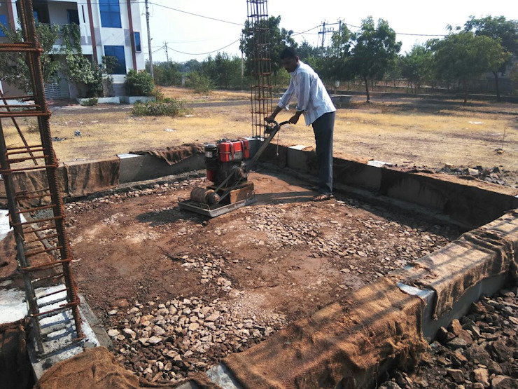 Earth soil compaction by Plate compactor by Cfolios Design And Construction Solutions Pvt Ltd Modern