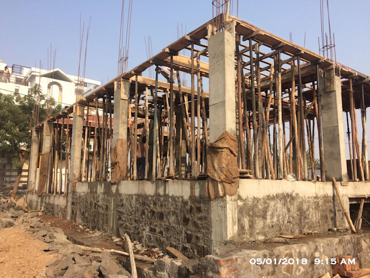 Beam bottom shuttering and support fixing by Cfolios Design And Construction Solutions Pvt Ltd Modern