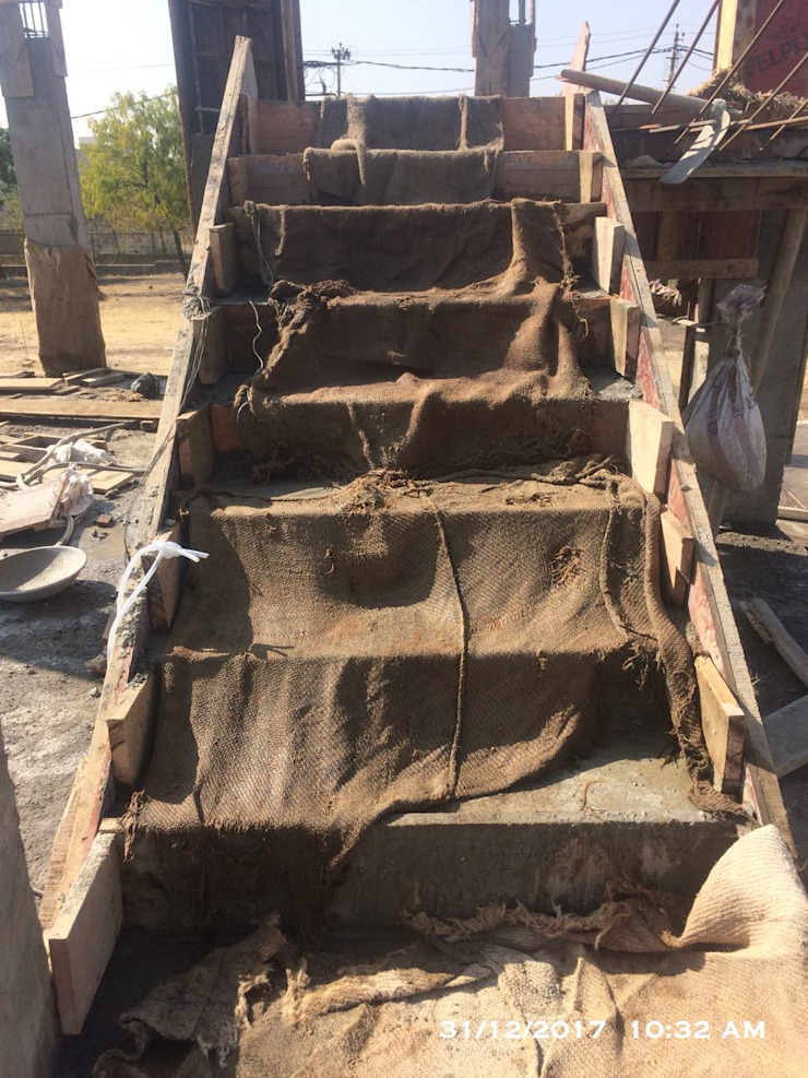 Casting of RCC Staircase by Cfolios Design And Construction Solutions Pvt Ltd Modern