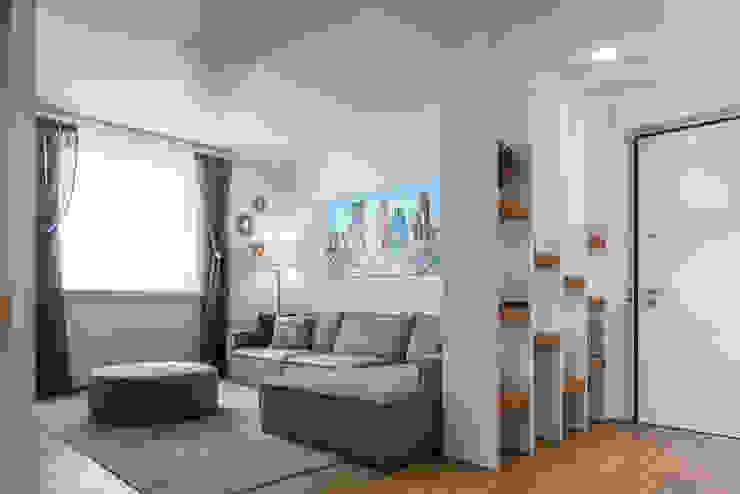 Moderne Wohnzimmer von QUADRASTUDIO Modern Holz Holznachbildung