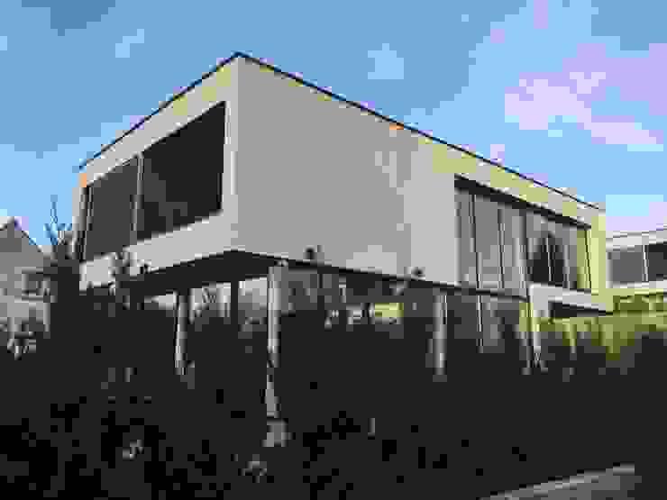 EC-Bois | Villa Carré | Bussy-Saint-Georges: Maisons de style  par EC-BOIS, Moderne Bois d'ingénierie Transparent