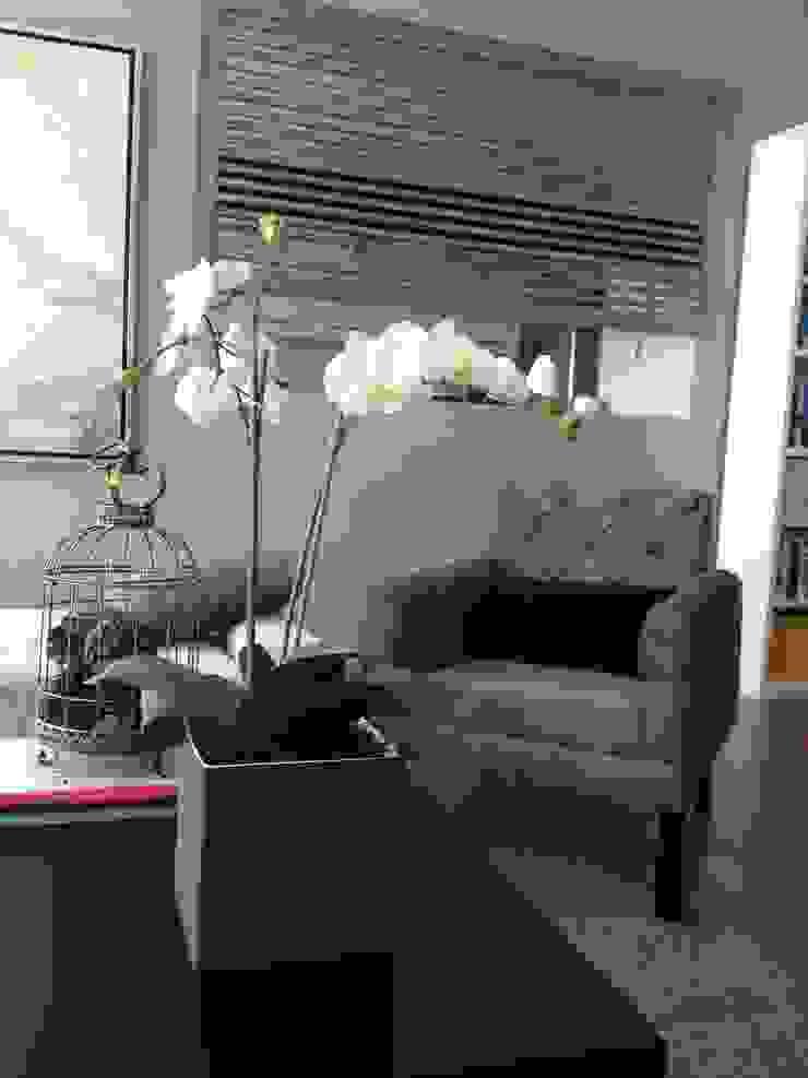 sillón de MIRIAM ESCOBEDO INTERIORISTA Moderno Textil Ámbar/Dorado
