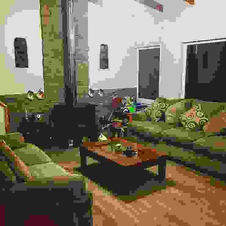 Living Livings de estilo de homify Rural Piedra