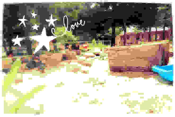 Arenero infantil casa rural - Arquitectos en Coyhaique Jardines con piedras