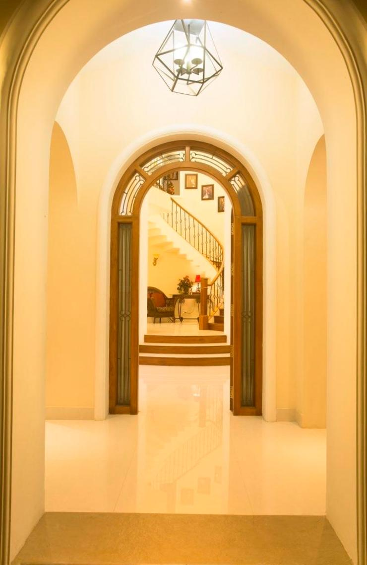 The House of Arches Mediterranean style corridor, hallway and stairs by S Squared Architects Pvt Ltd. Mediterranean Bricks