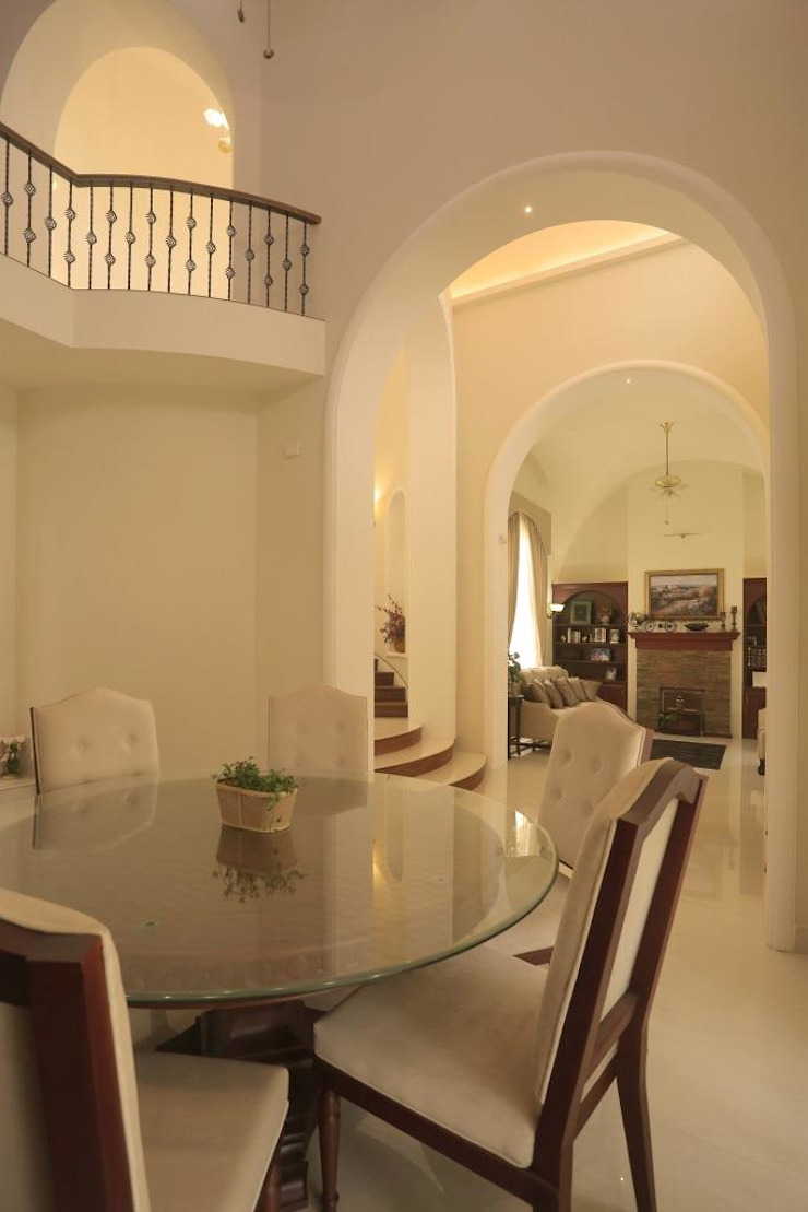 The House of Arches Mediterranean style dining room by S Squared Architects Pvt Ltd. Mediterranean