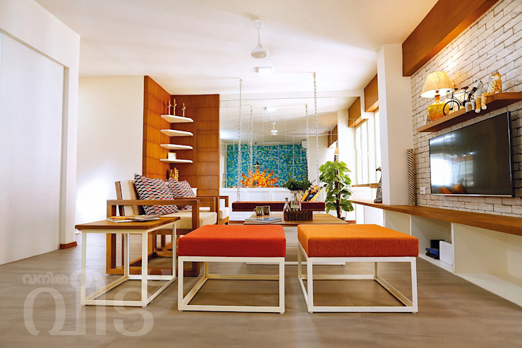 The Rising Sun Apartment Eclectic style living room by S Squared Architects Pvt Ltd. Eclectic