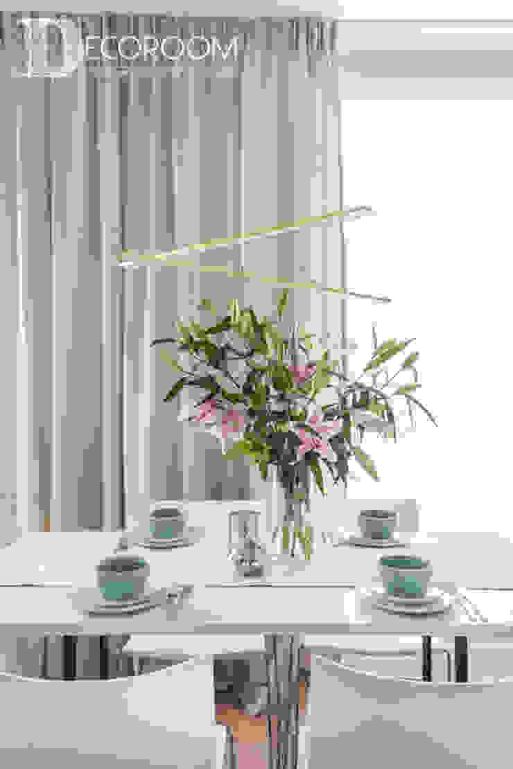 Modern dining room by Decoroom Modern