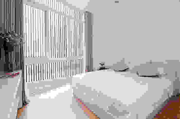 Dormitorios modernos de Công ty TNHH Xây Dựng TM – DV Song Phát Moderno