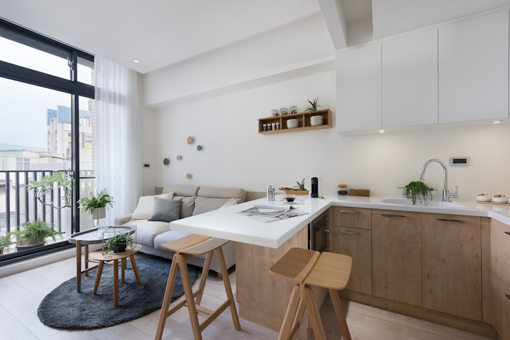 Dining room by 寓子設計,